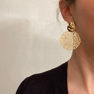 Textured filigree gold toned statement earrings